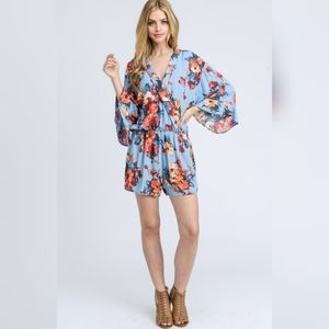 ee:some FLORAL PRINT SURPLICE RUFFLE ROMPER